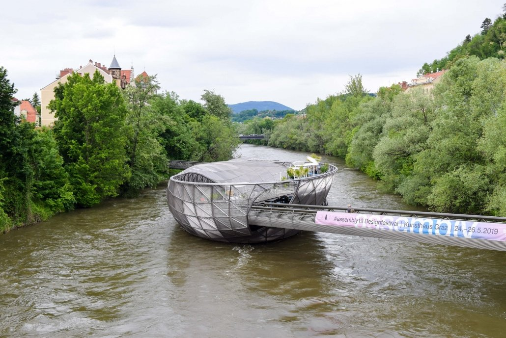 Things to do in Graz, visit Murinsel a steel boat sitting on River Mur.